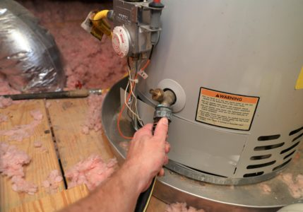 water heater with drain pan underneath