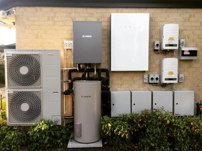 Tank and tankless water heaters installed outdoors