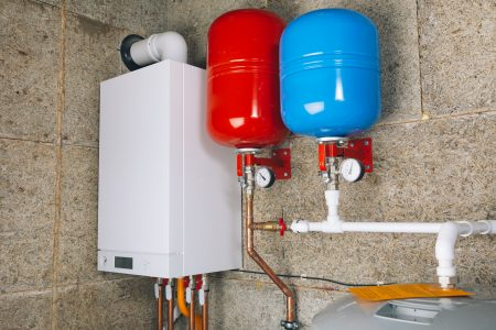 Water heating system with expansion tanks