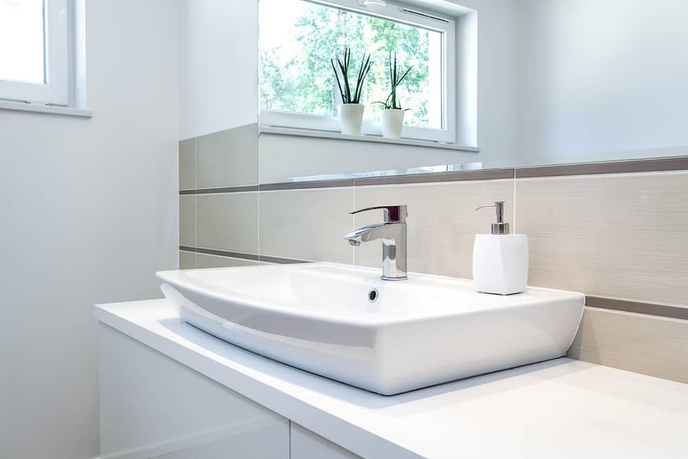 A white bathroom faucet