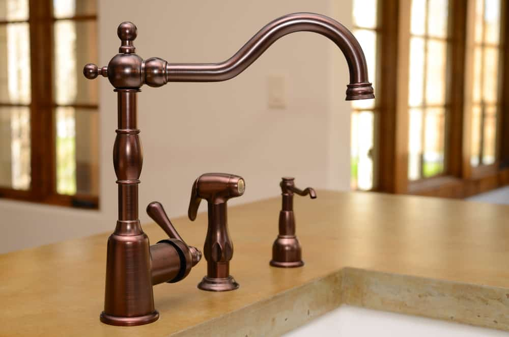 A vintage bronze kitchen faucet