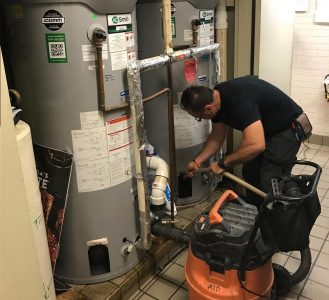 Man flushing a water heater