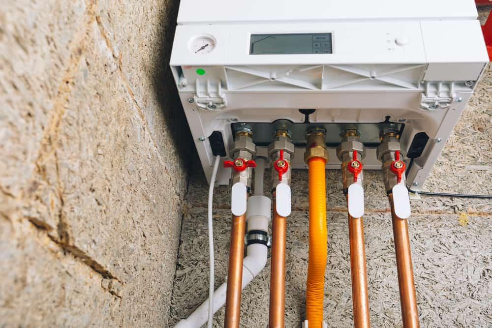Tankless water heater piping system