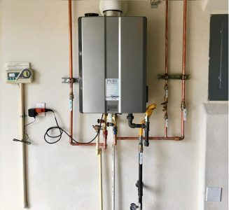 Tankless water heating system mounted on the wall