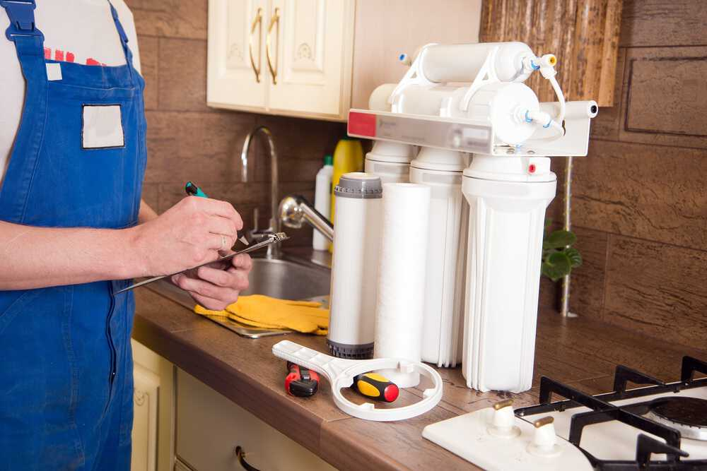Plumber changing a water filter