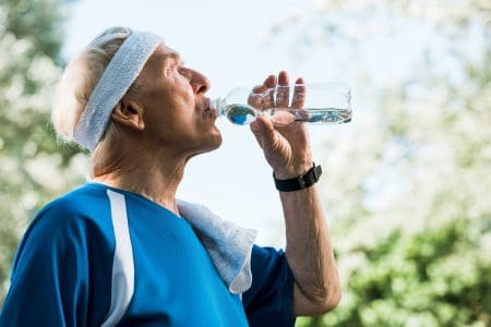 Elderly man drinking alkaline water