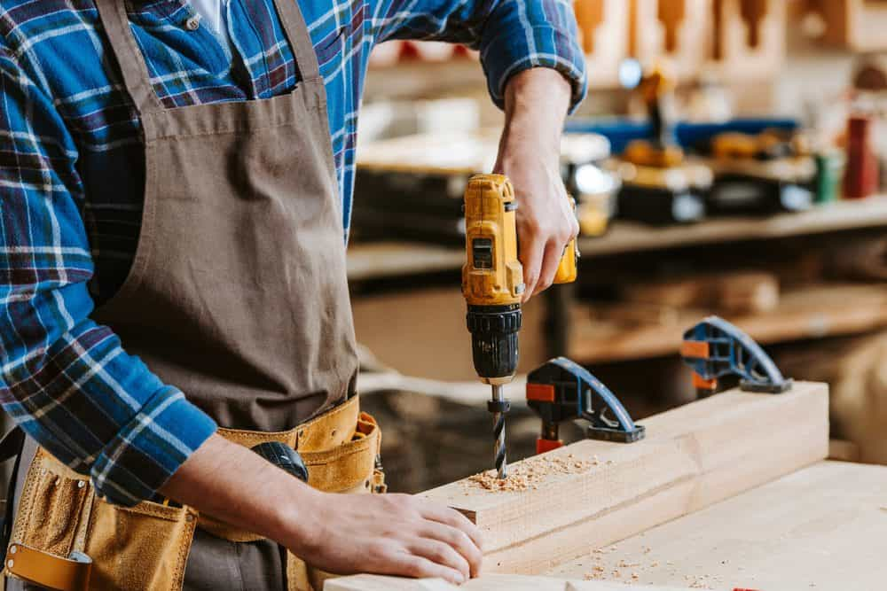 Man drilling on wood with an impact driver
