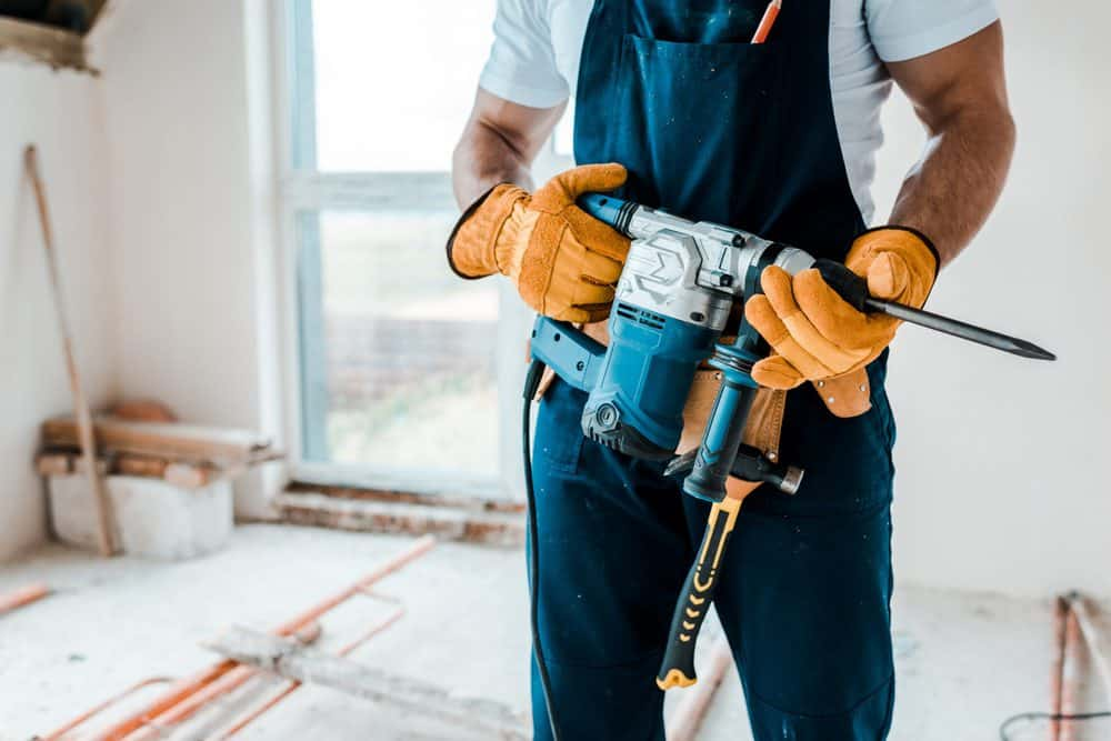 Man working with a hammer drill