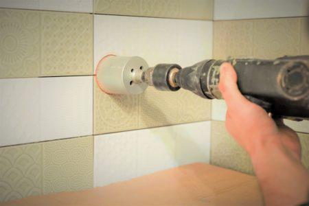 Man drilling through tile