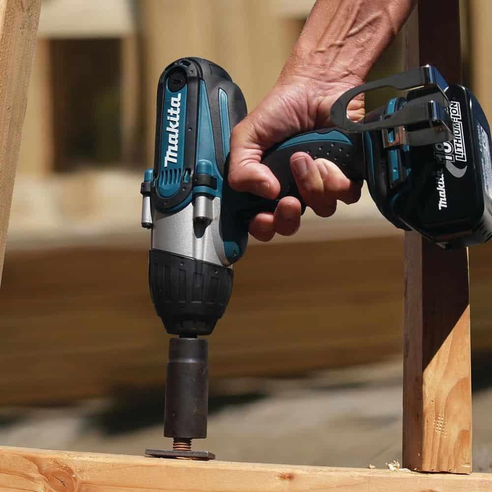 Man holding a Makita drill