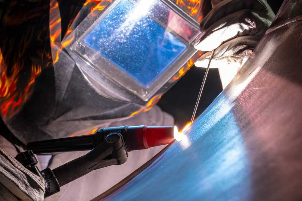 Man TIG welding stainless steel