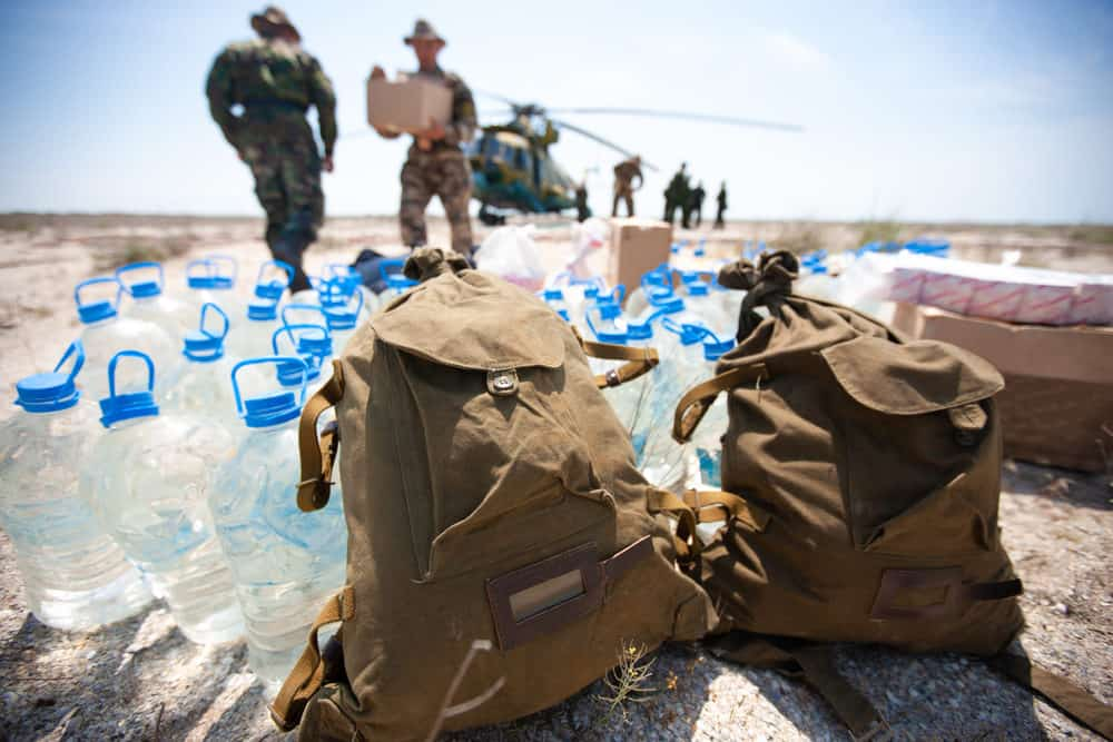 Army soldiers delivering bottle water