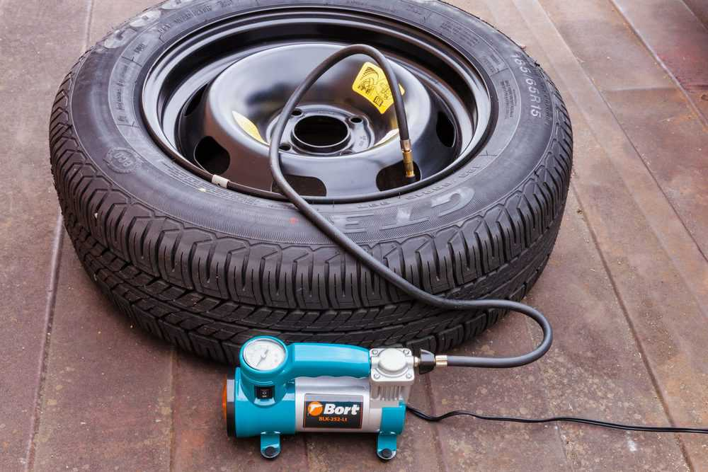 Inflating car tire with portable inflator
