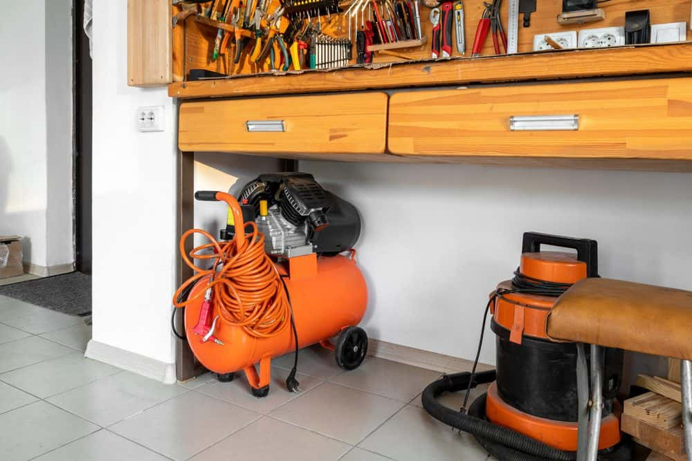 Orange small portable shop air compressor