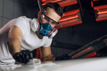 Worker wearing a welding respirator