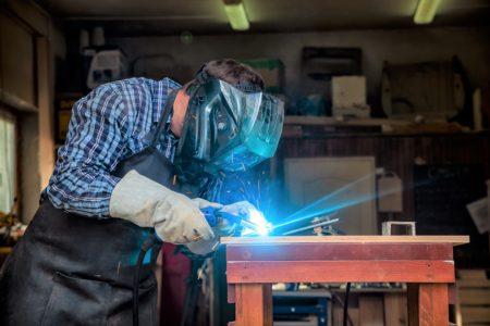 Welder working on a welding table