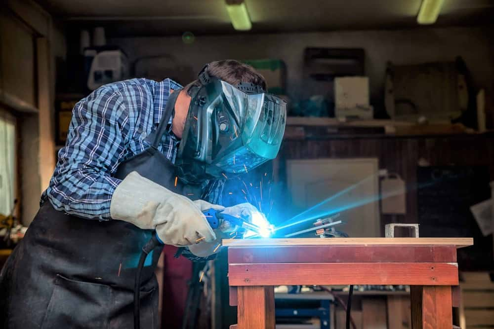 Welder working on a welding table