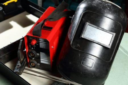 Welding unit with helmet shield