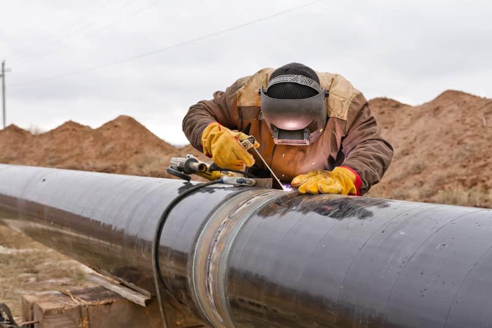 Welding working on gas pipeline