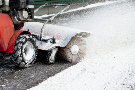 Removing light snow with electric snow blower