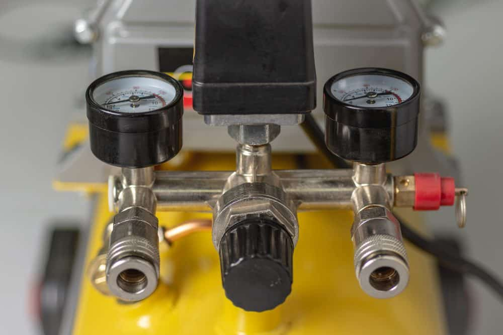 An air compressor pressure regulator
