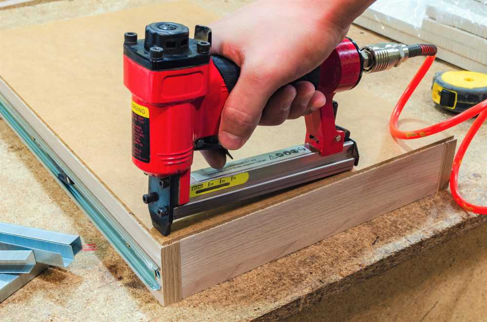 Pneumatic stapler nails the bottom to the drawer