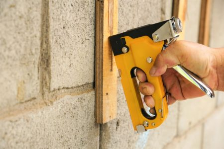 Heavy duty staple gun in use with wood work