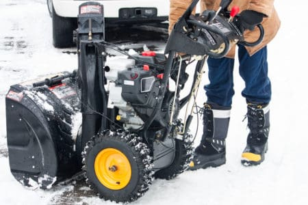Woman with a new snow blower