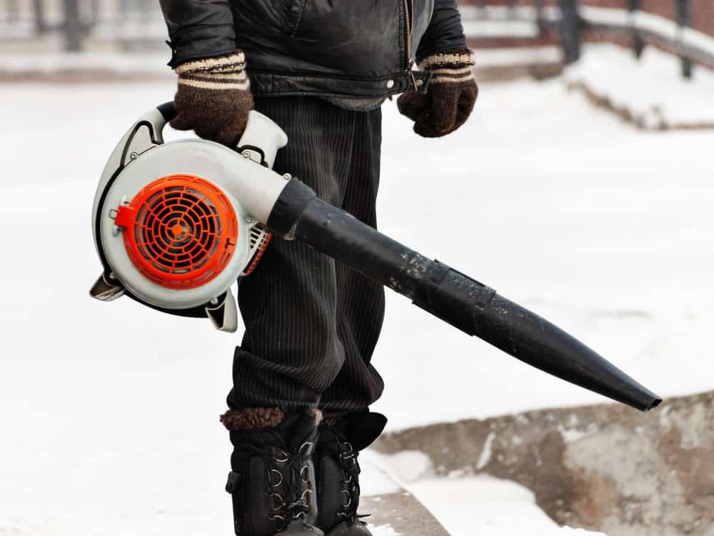 Man using leaf blower for snow