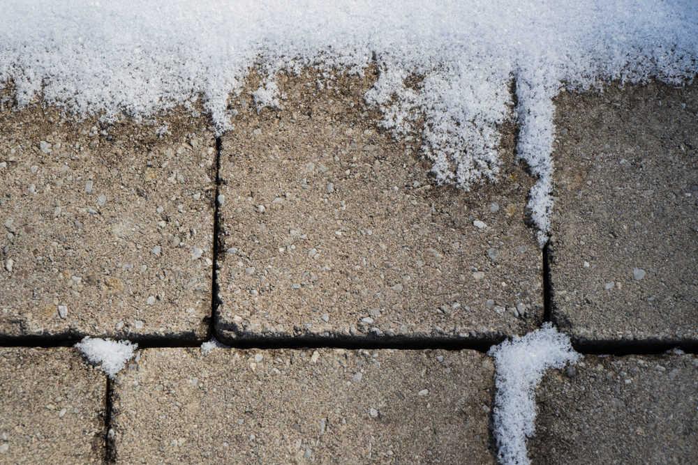 Melting snow on gravel