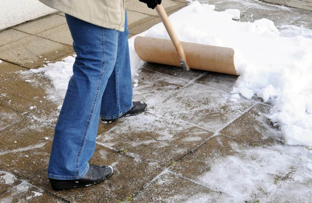 Shoveling snow from gravel