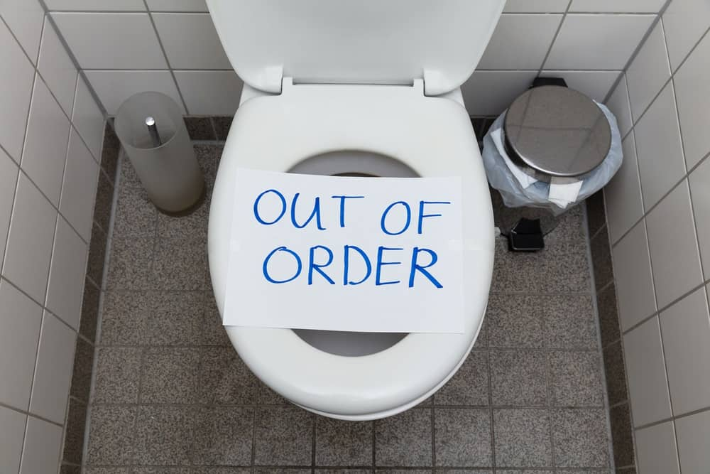 Out Of Order Text On Toilet Bowl