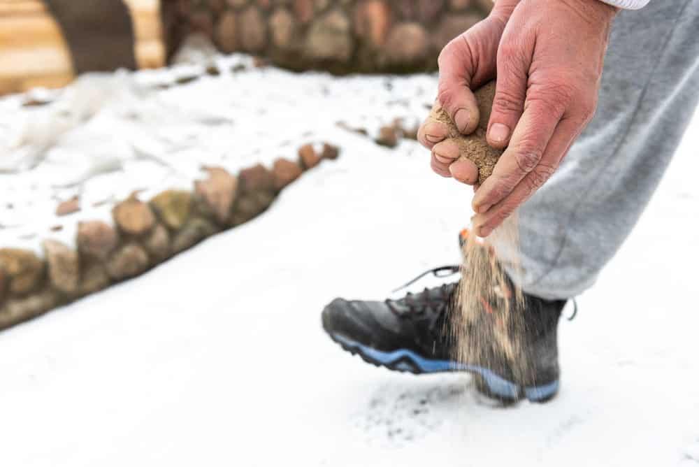 Sanding snow covered ground