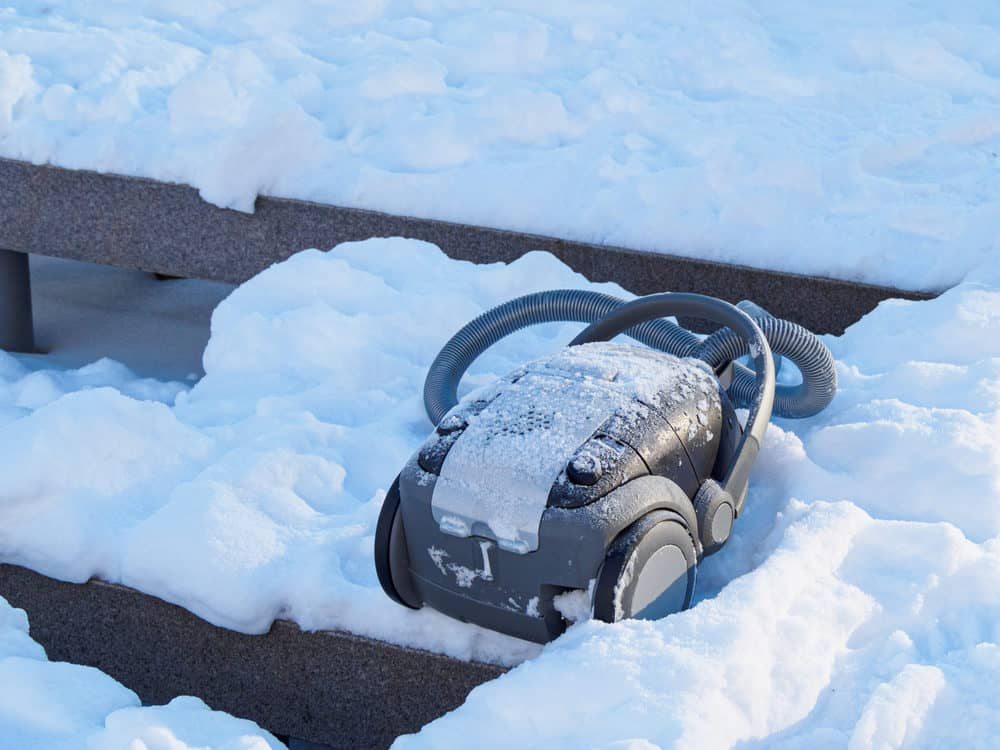 Discarded vacuum cleaner outdoors in the snow