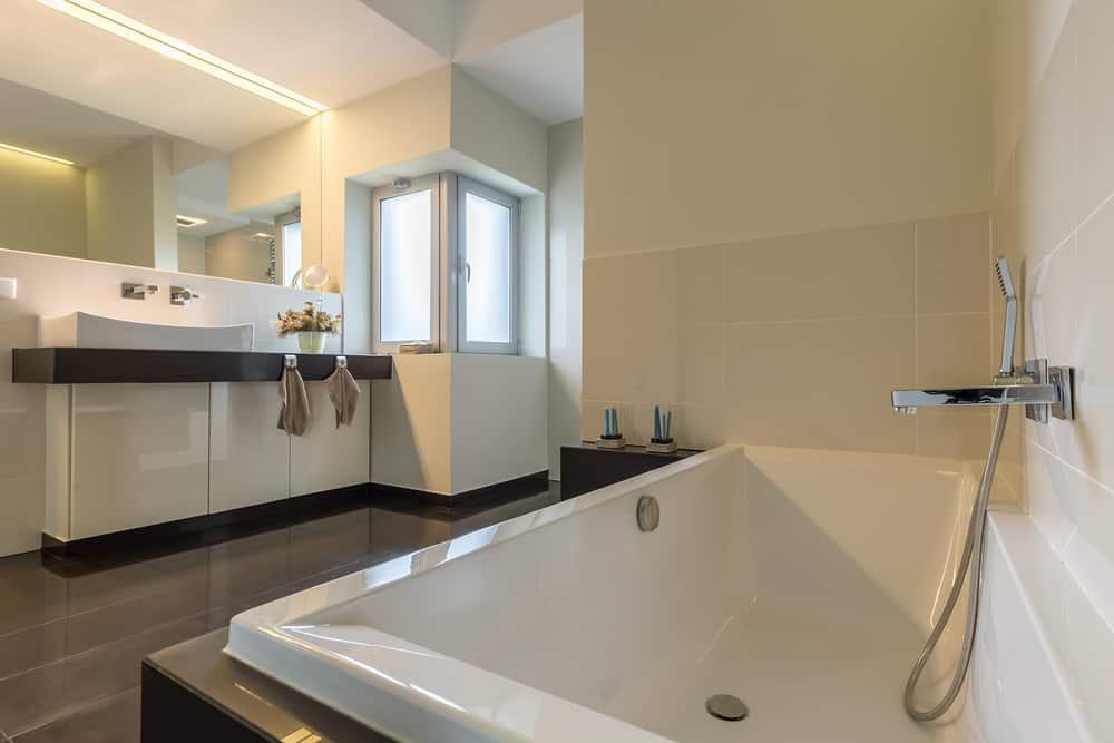 Minimalistic bathtub in modern bathroom