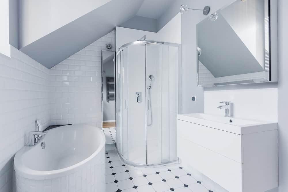 Small bright bathroom in classic modern style with fiberglass shower
