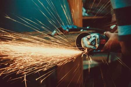 Spurks flying during cutting with an angle grinder