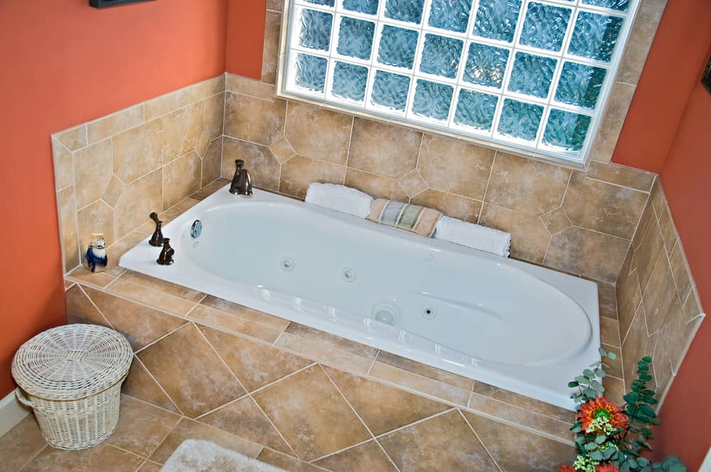 Modern colorful bathroom tub area.