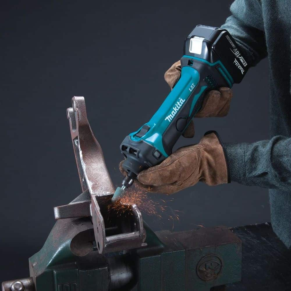 Person holding a die grinder closeup