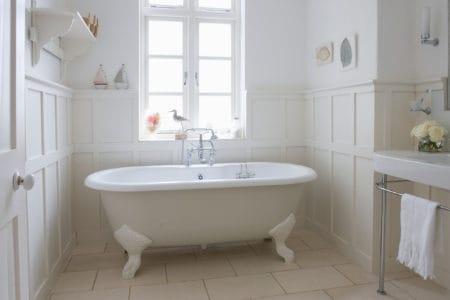 Modern white bathroom with a portable bathtub