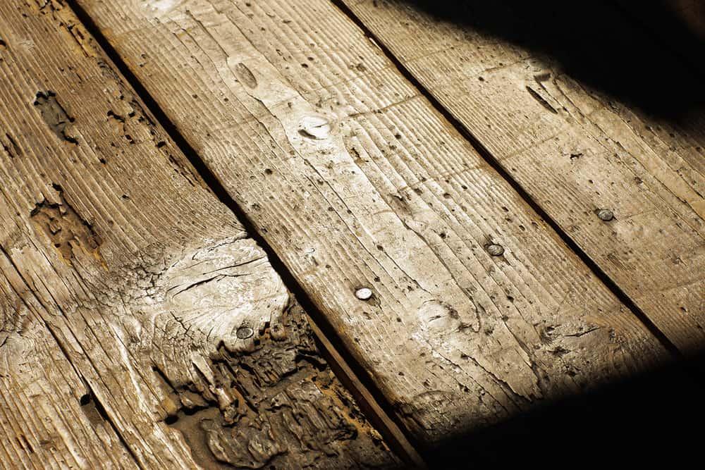 Old wood floor with cracks closeup