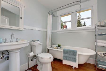 Interior design of craftsman bathroom with pastel blue walls