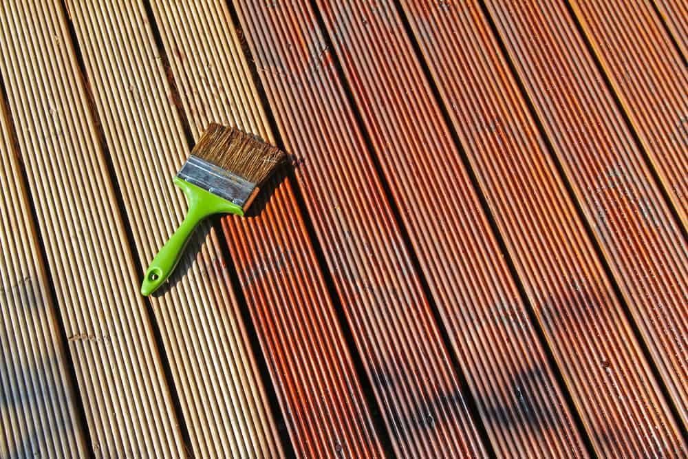 Paint brush on a wooden deck