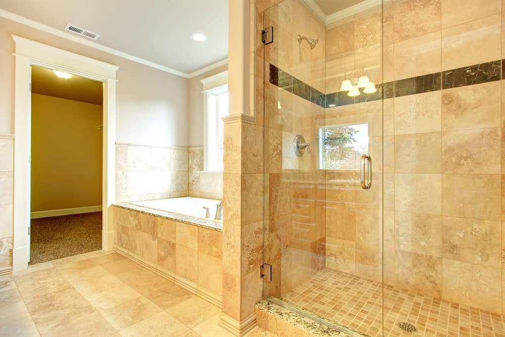 Cozy bathroom with tub and glass door shower