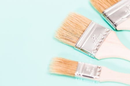 Three paint brushes in varying size