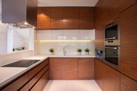 Wooden kitchen cabinet in brown white kitchen