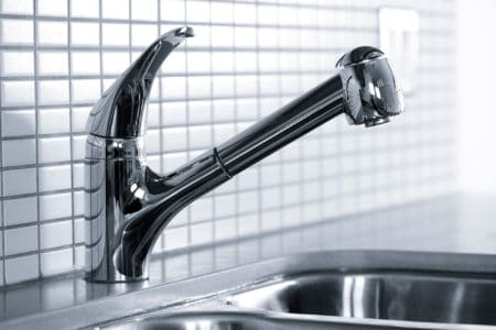 Silver kitchen faucet closeup