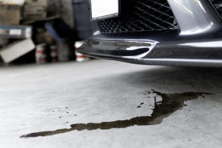 Engine oil stains from a car on the driveway