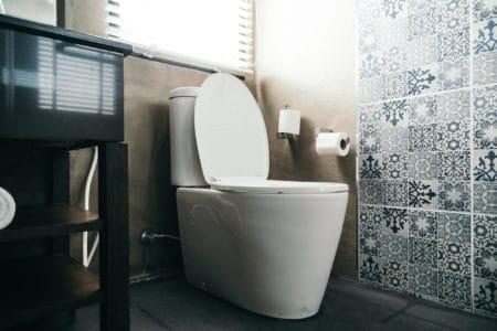 Clean bathroom with toilet bowl in focus