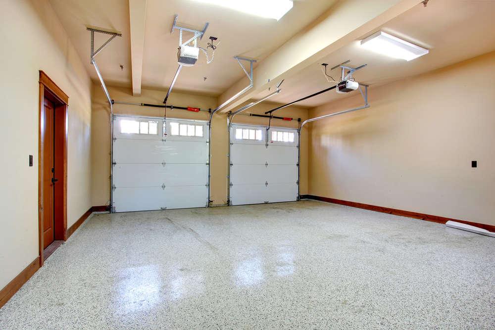 Empty garage with roller door. View of horizontal tracks.